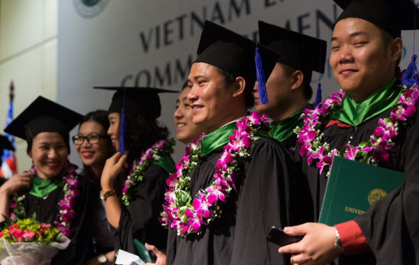Vietnam Executive MBA students stand in line for their graduation ceremony.